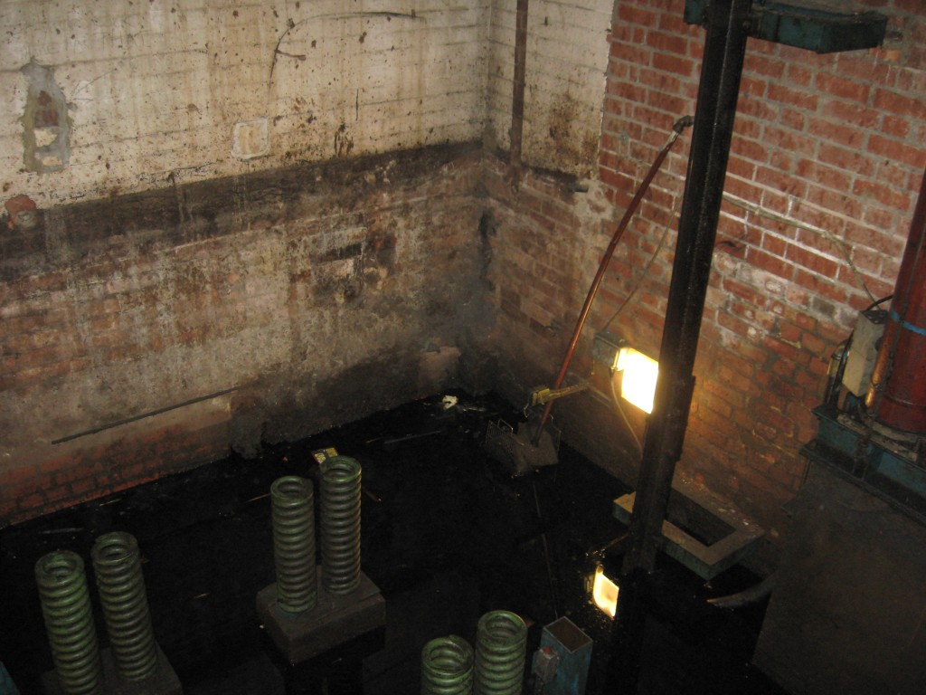 Flooded lift pit in a factory
