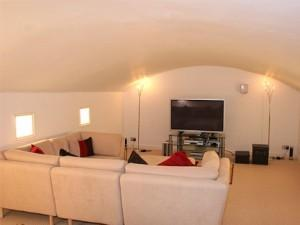 Vaulted ceiling rendered and new TV room created