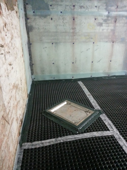 Manhole covers in the floor sealed as part of the waterproofing regime