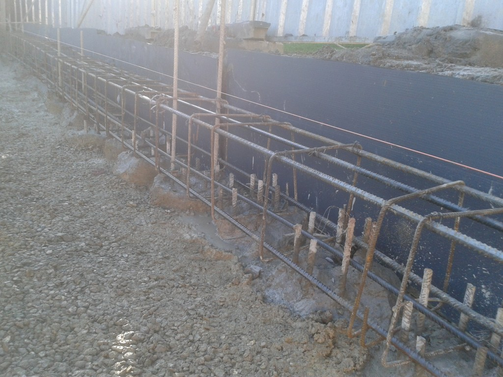 Heads of concrete piles linked with all with a ground beam