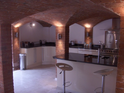 Exposed brick ceiling lit to give dramatic look
