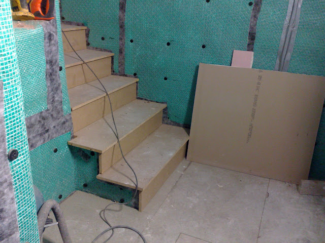 Stairs waterproofed and covered with new treads and risers