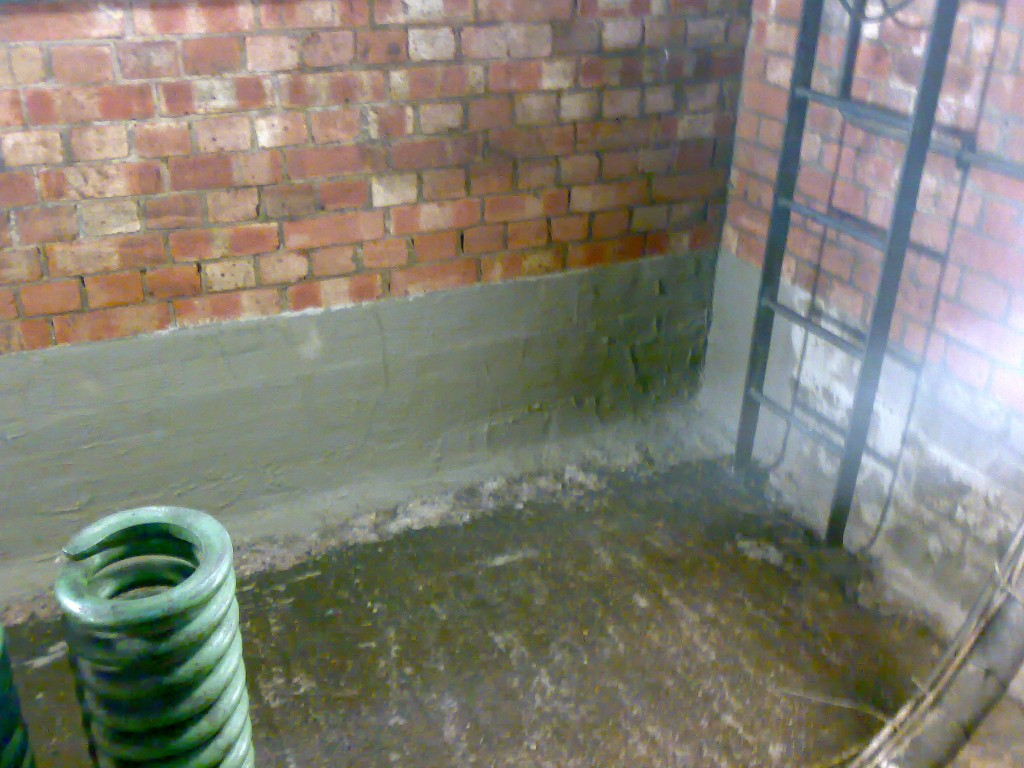 Walls coated with cementitious slurry