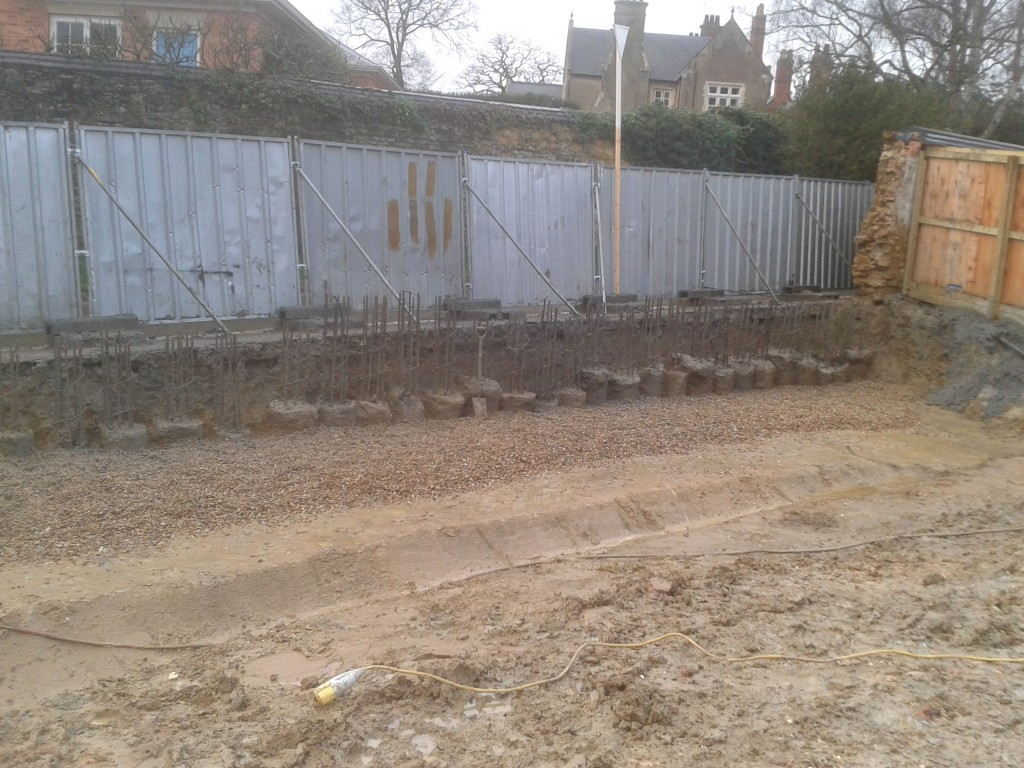 Concrete piles drilled and cast to hold busy junction back