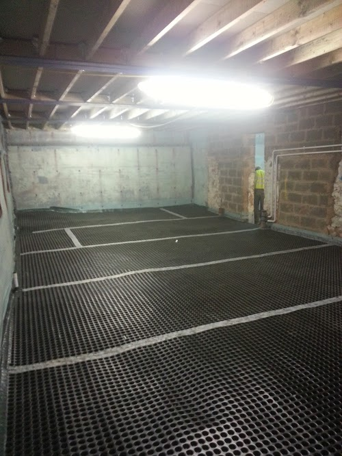 Flooring covered with tougher & thicker membrane than the walls