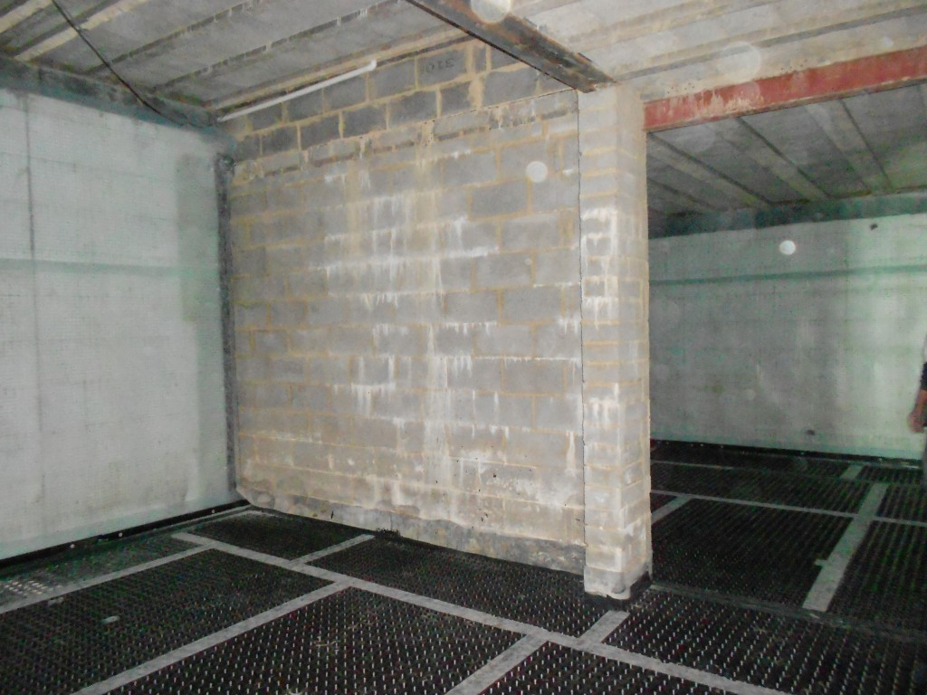 Internall walls built off damp proof membranes and linked to cavity drainage membranes