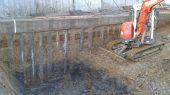 Excavation next to concrete piles