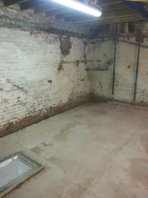 Walls and floor cleaned before waterproofing works