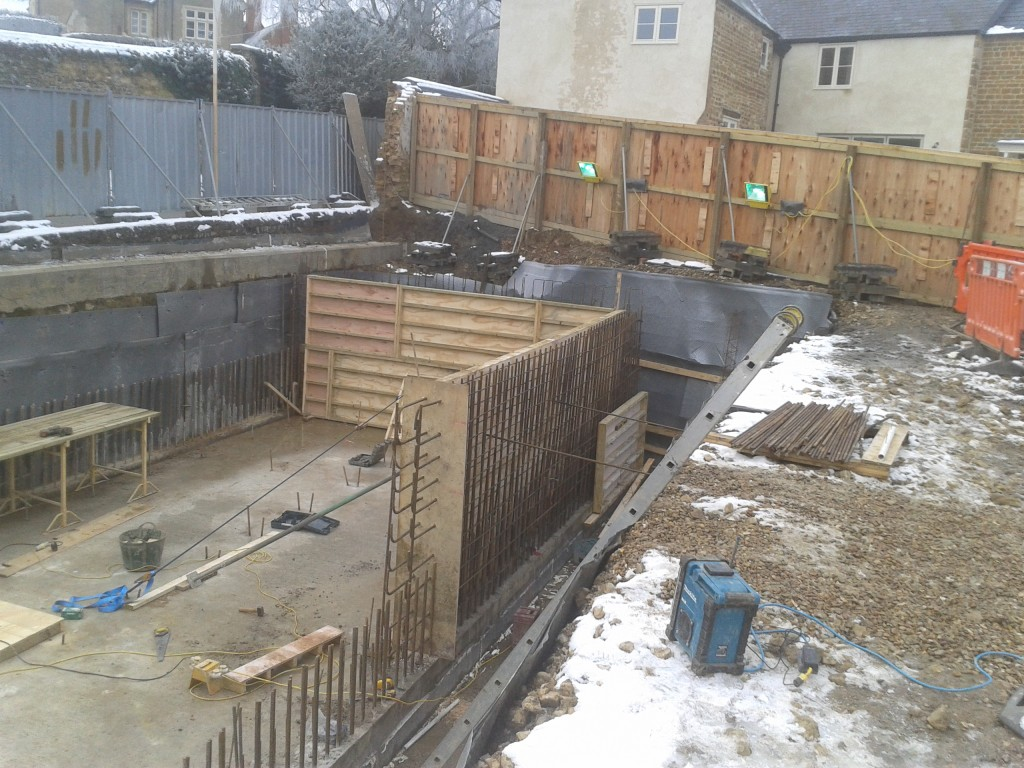 Basement walls built using temporary timber shutters
