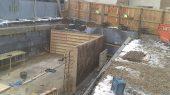 Basement walls built using temporary timber shutters