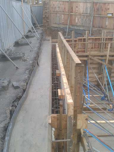 Ground beam forming the top of the walls