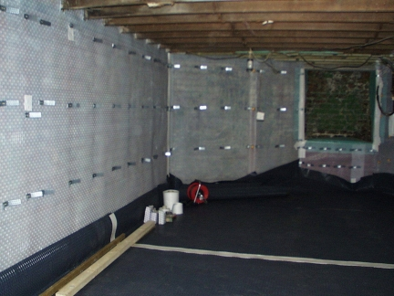 Walls and floor lined with cavity drainage membrane