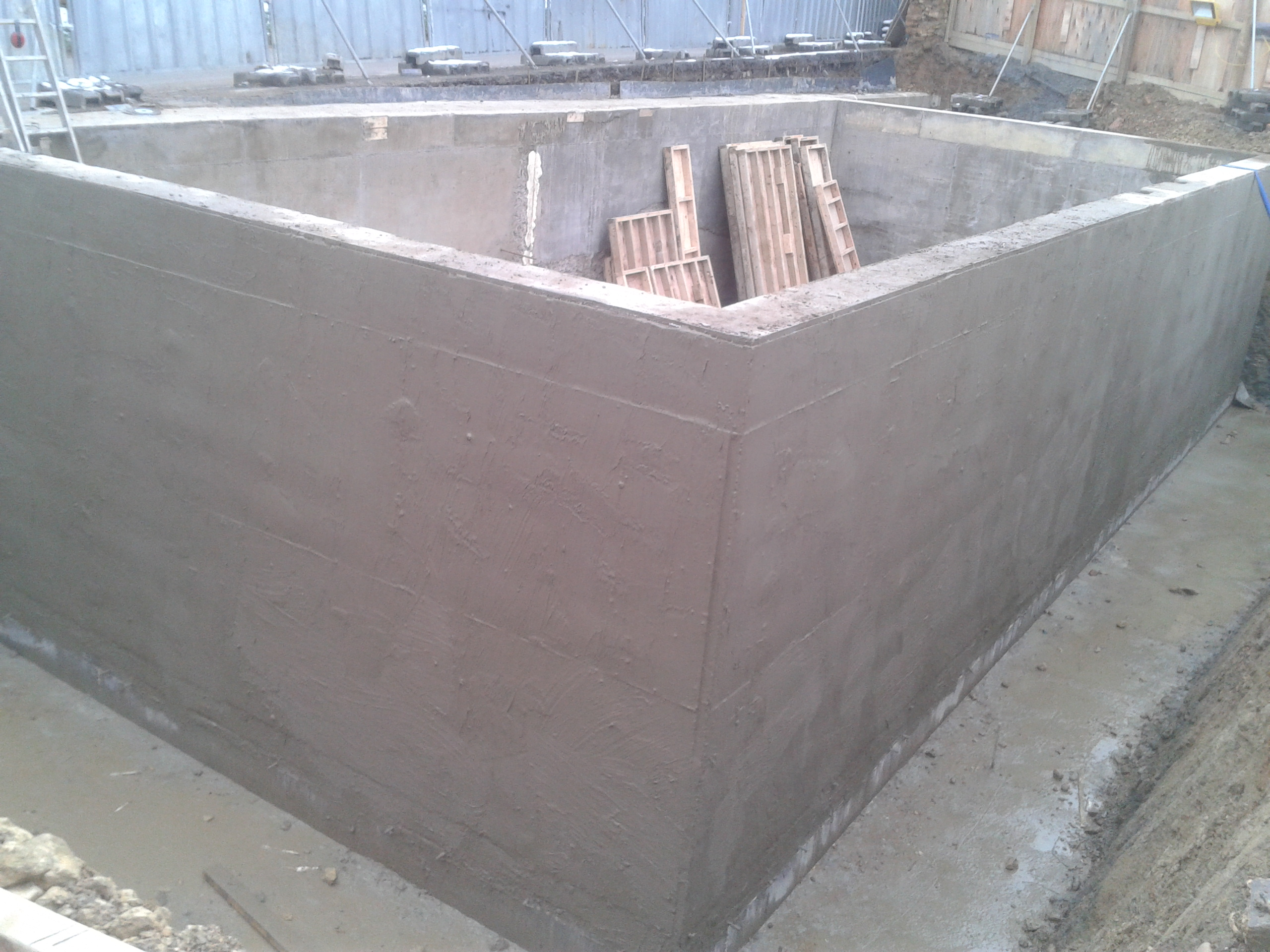 Cementitious slurry applied externally
