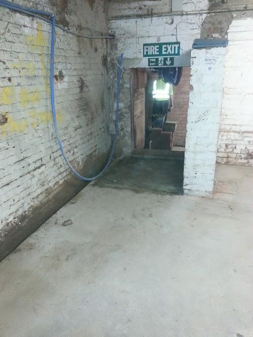 Concrete floor repaired and doorways created