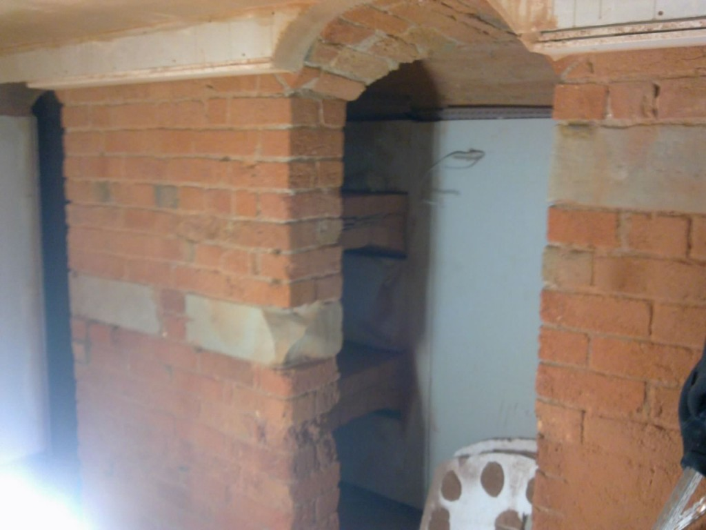 Internal walls cleaned to expose original brick