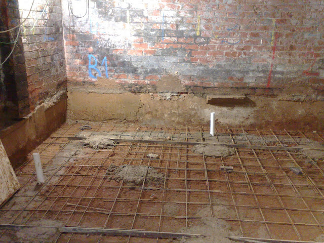 Underground drains run under the new slab with inlets standing up
