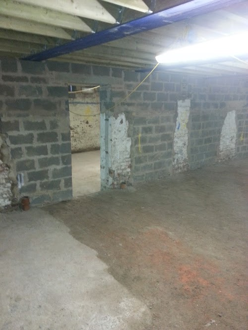 New internal doorways between old factory rooms create two student apartments