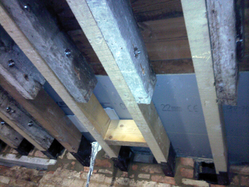 Ground floor joists bolstered with new timbers to give more strength and remove supports below