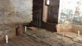 Steel rails used to ensure new floor is poured level