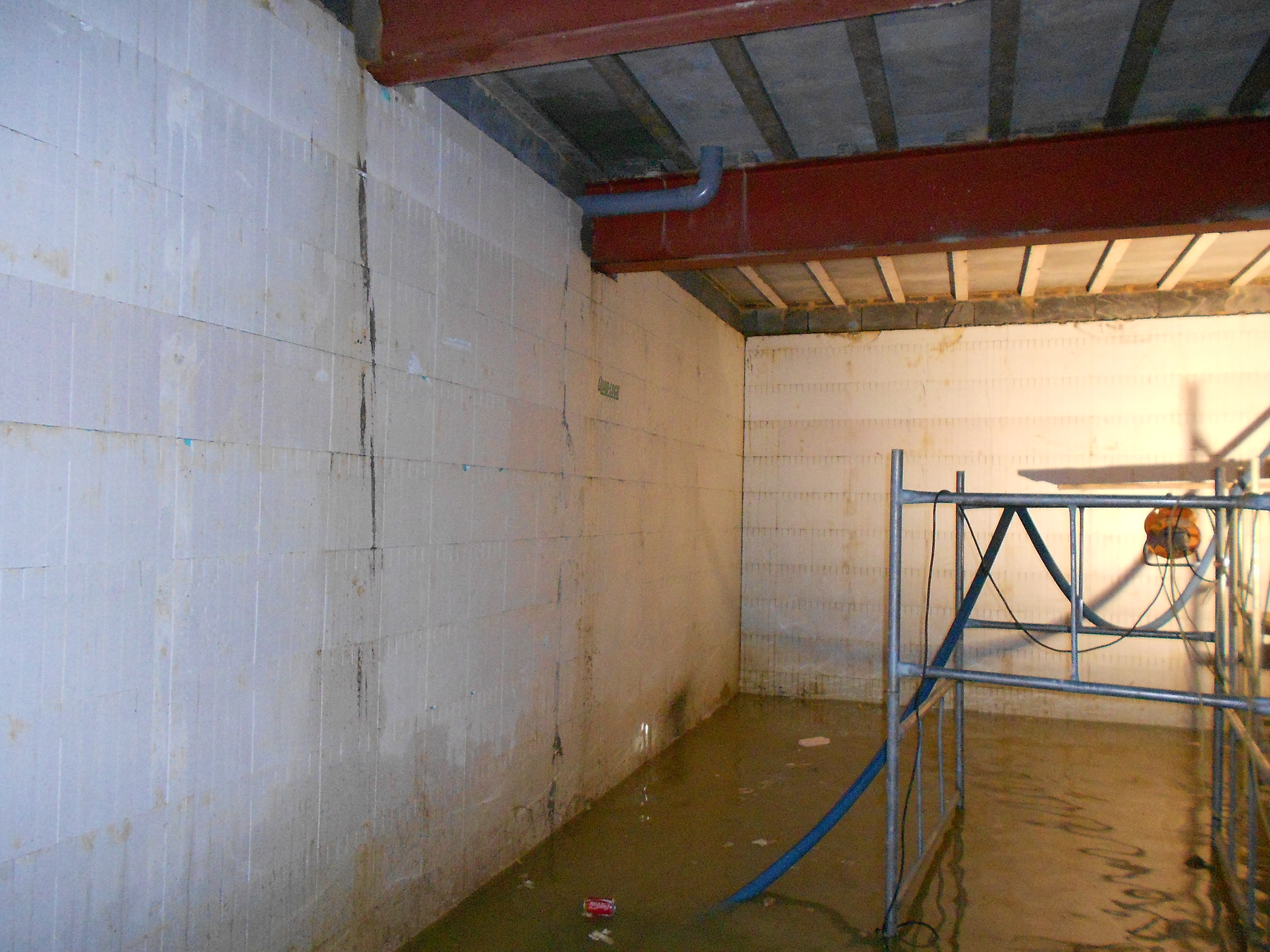 Constant pumping was required to dry the basement during works
