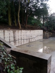 Large retaining wall holding back hillside