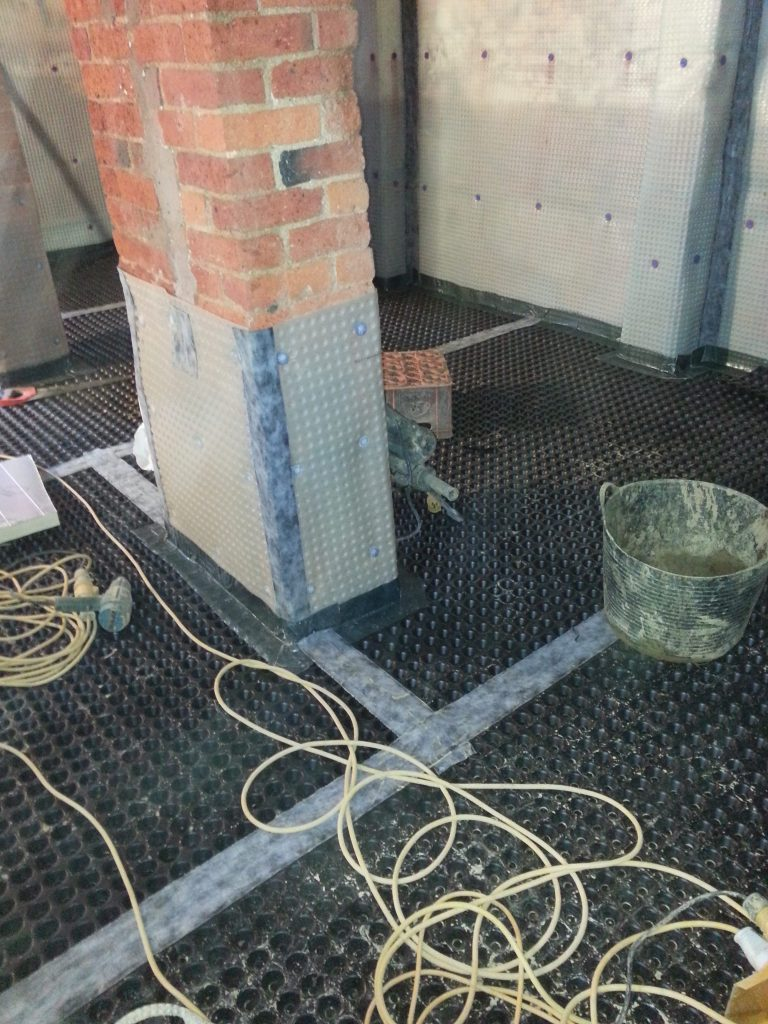 Central columns damp proofed and membraned to stop transfer of damp