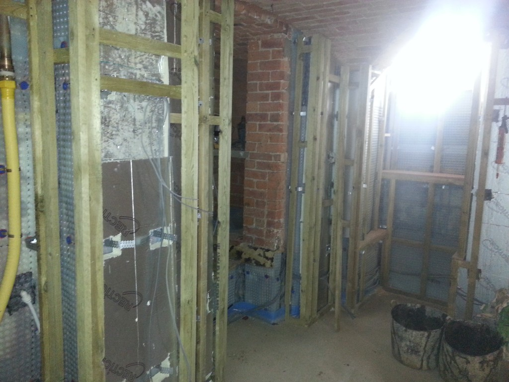 Gas, water and heating pipes along with cables run behind dry lining