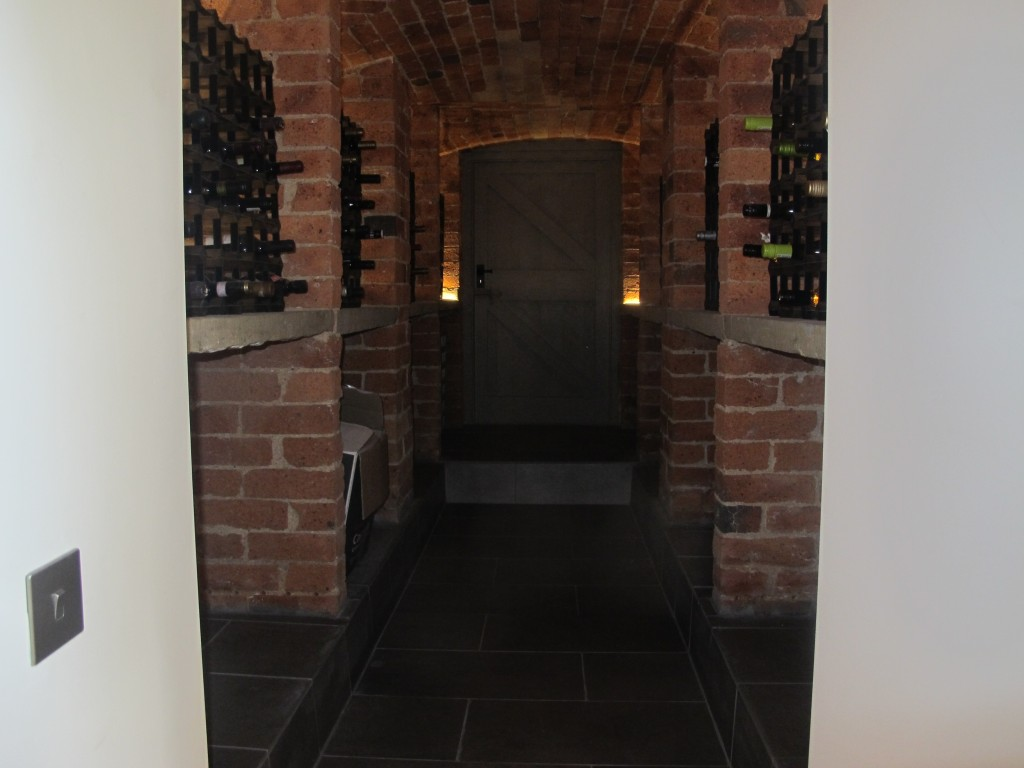 Shelved area used as a wine cellar