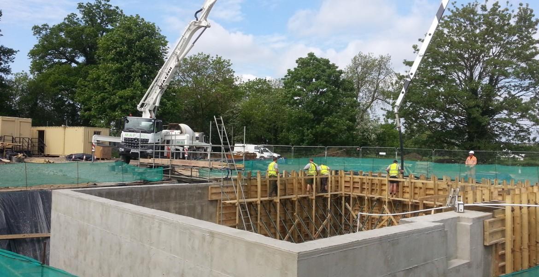 Large concrete pumps used to pour wall concrete