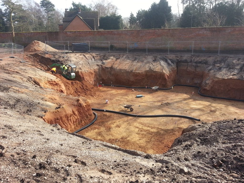 To keep the excavation clean and dry a perimeter drain is installed directing water to a permeant sump