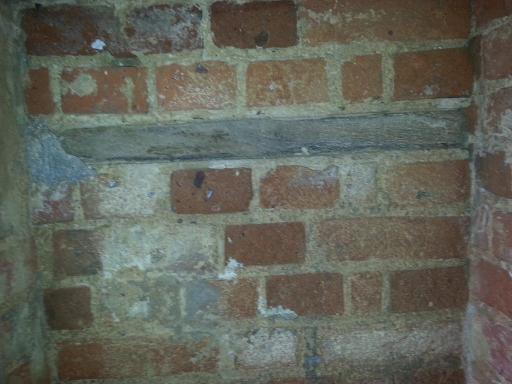 Timber in brick work that has been exposed