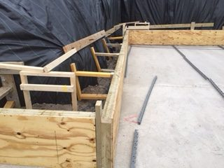 Basement slab is set out with timber shutters