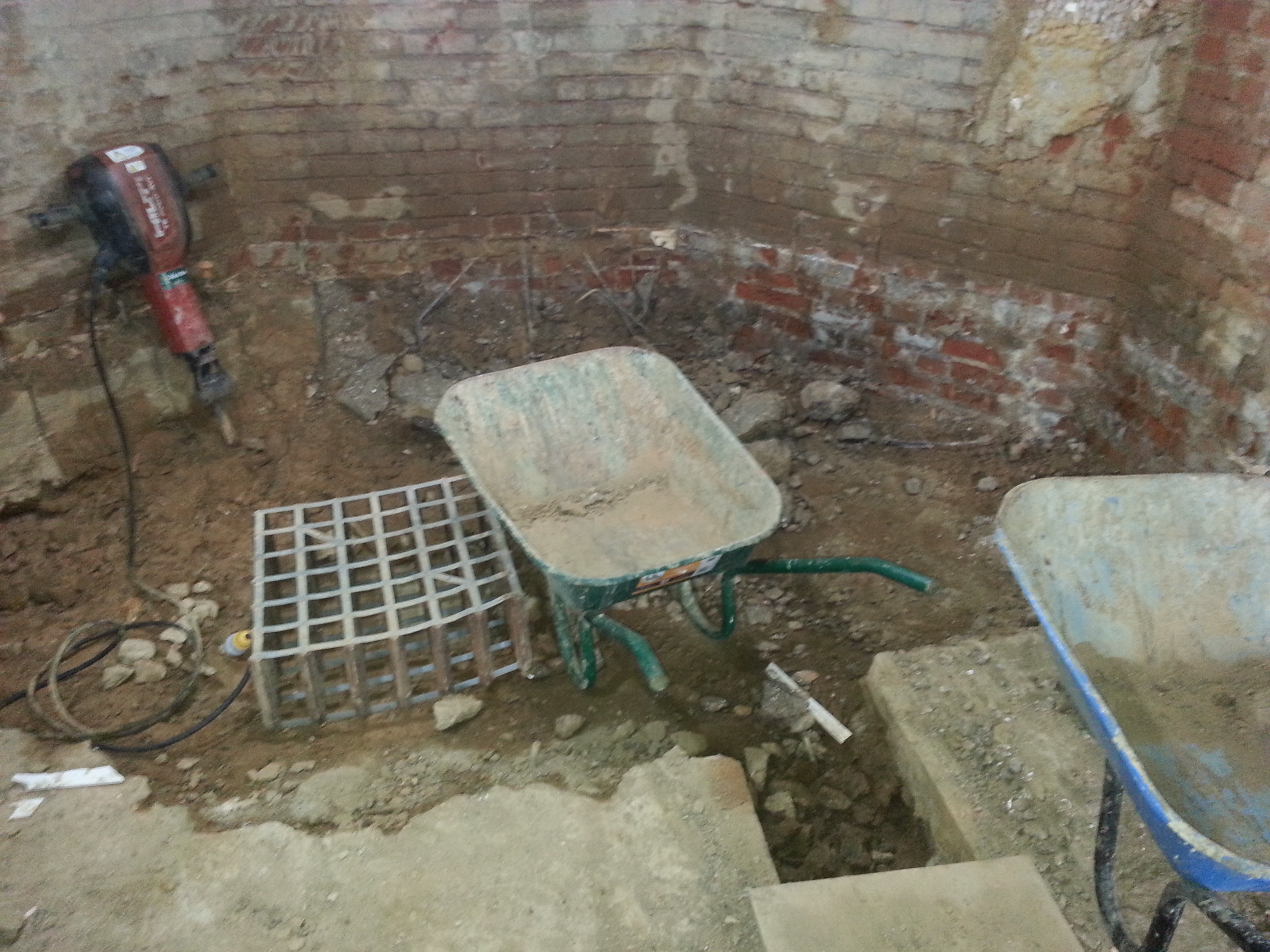 Underground drainage channels leading to sump excavation