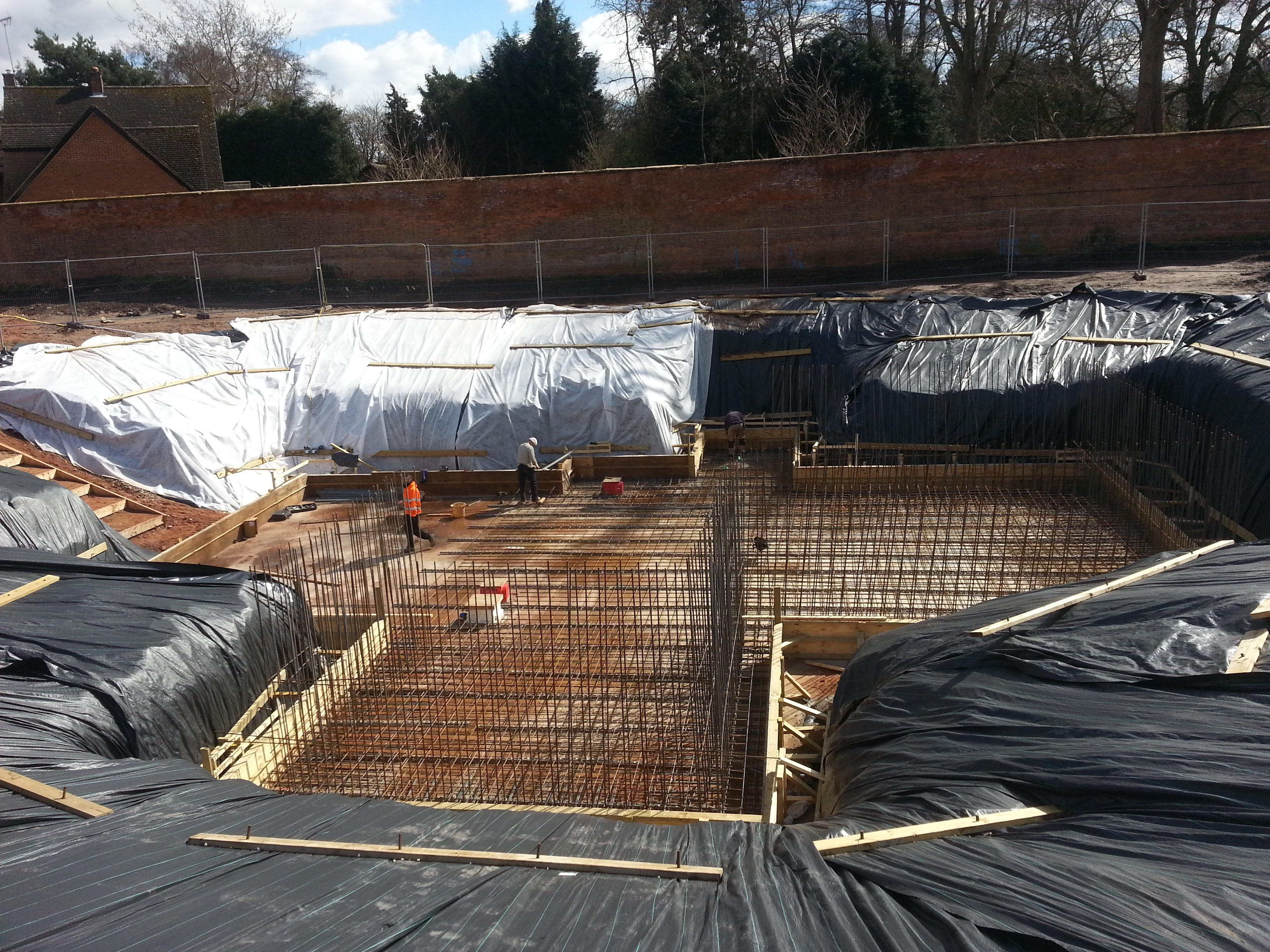 Steel linking the slab to the walls to create continuous reinforcing