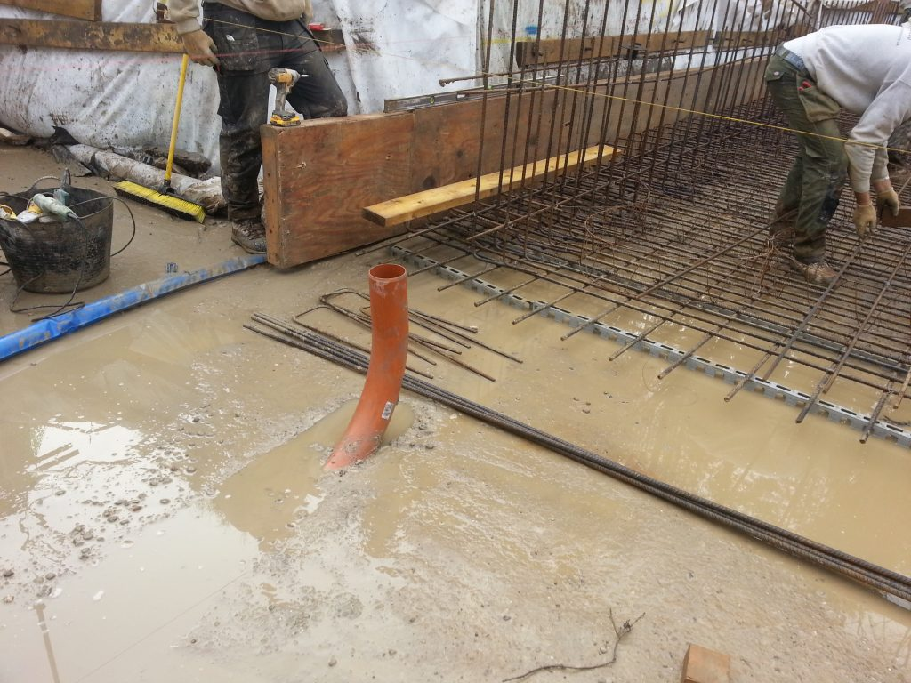 Pipe work for bathroom installed under main concrete base reinforcing