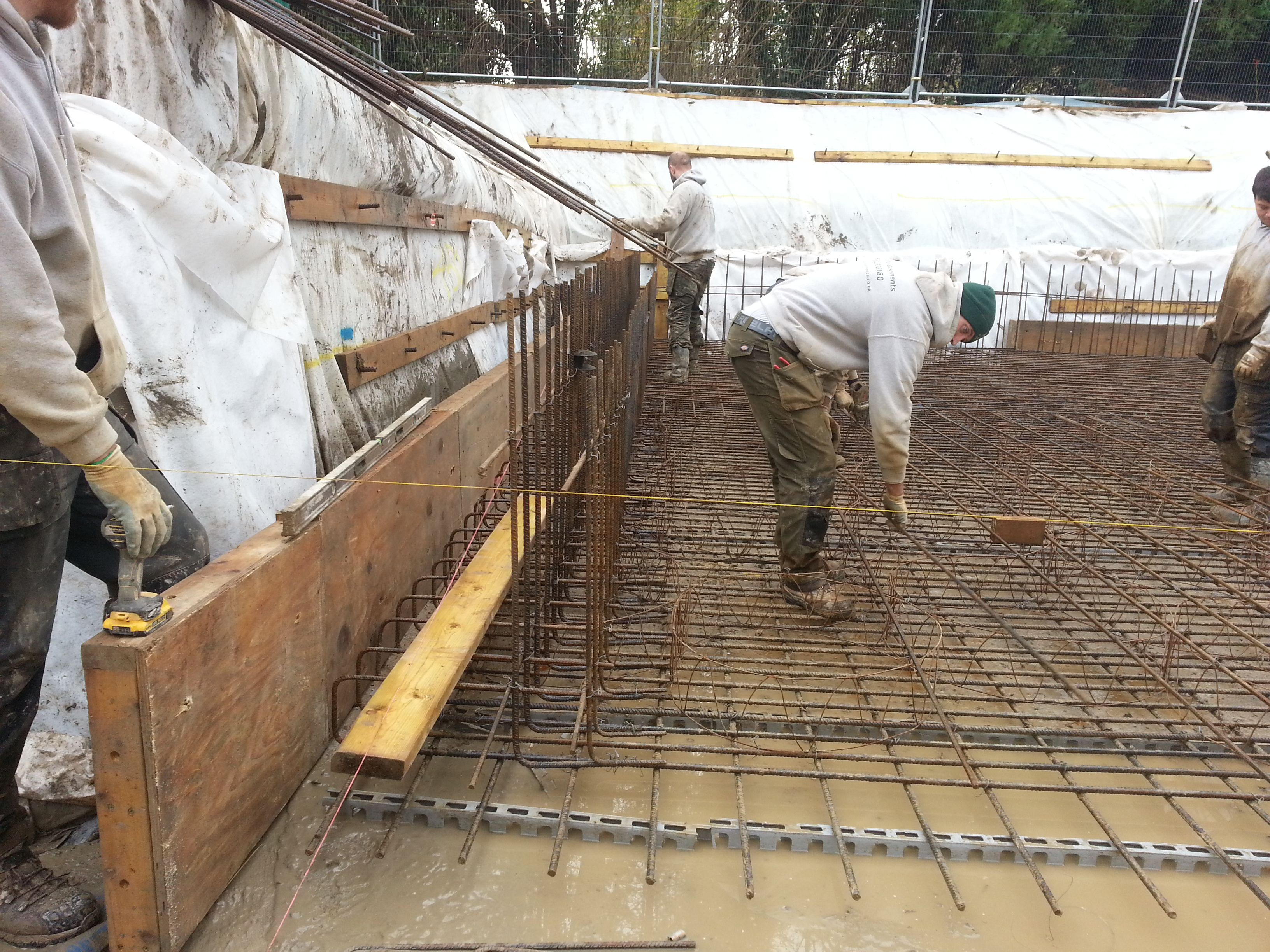 Reinforcing bars set out using string lines to allow continuity with the wall reinforcing above