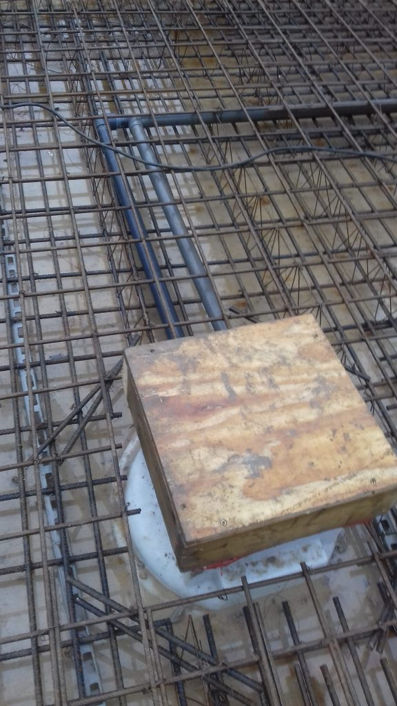 Reinforcing around sumps to reduce cracking