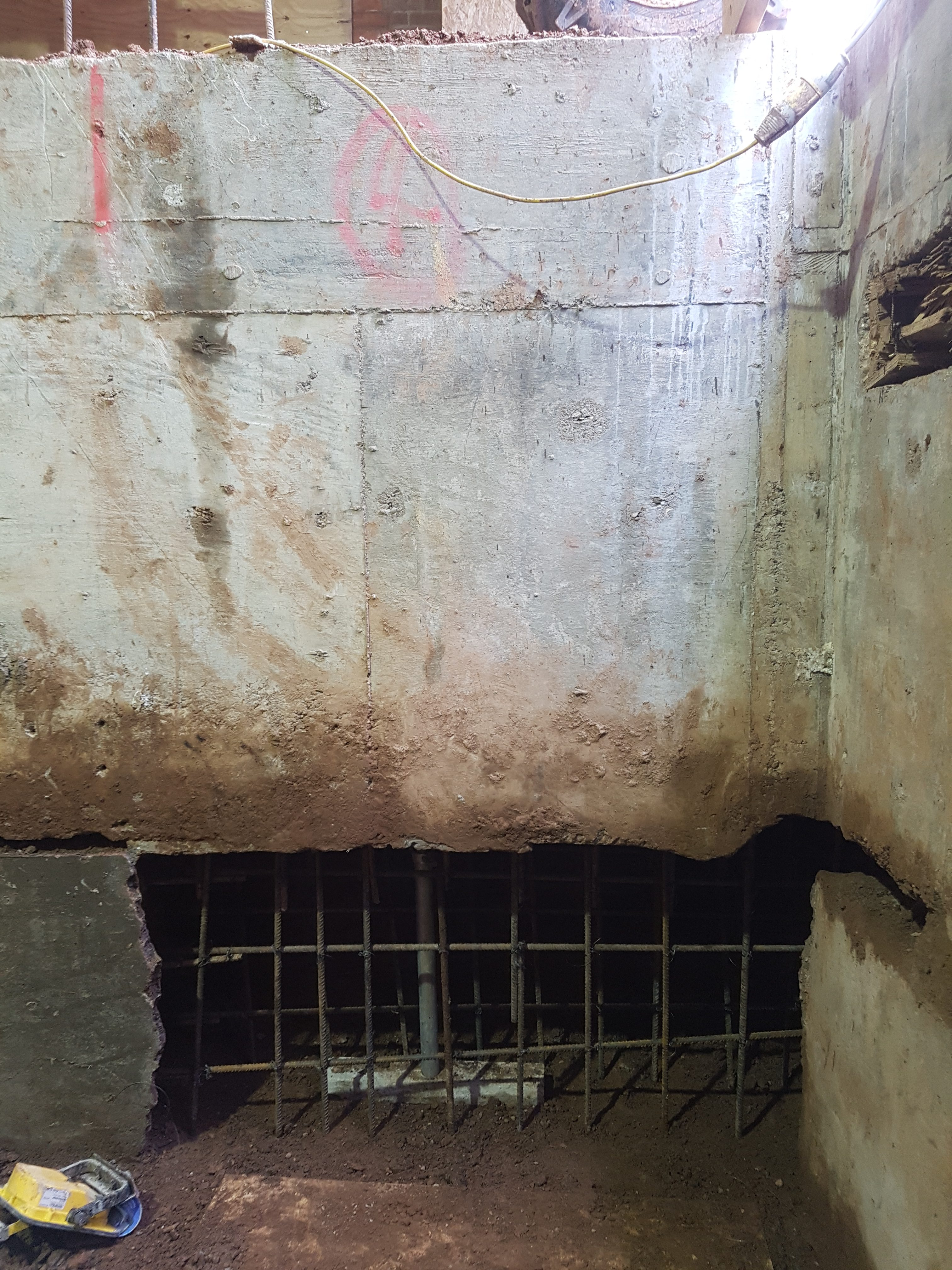 Second layer of underpinning with steel reinforcing