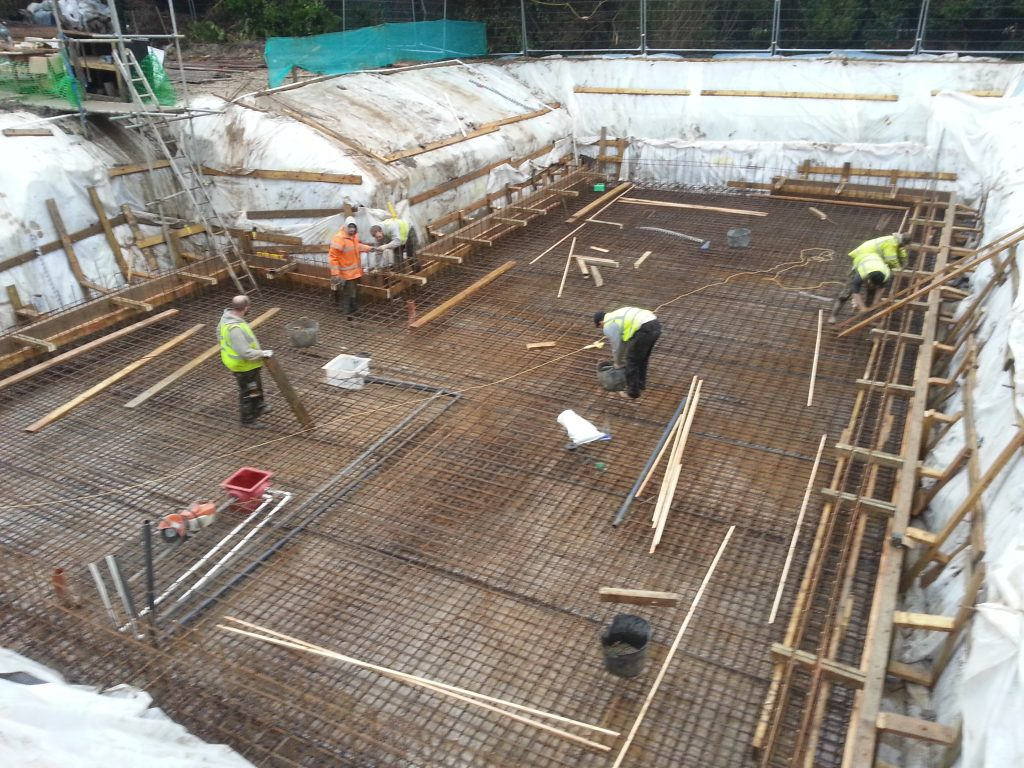 The basement slab includes the first 150mm of walls, called a kicker, to move the waterproofing point of weakness higher