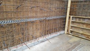 Steel bars going through both sides of the shuttering to join them together