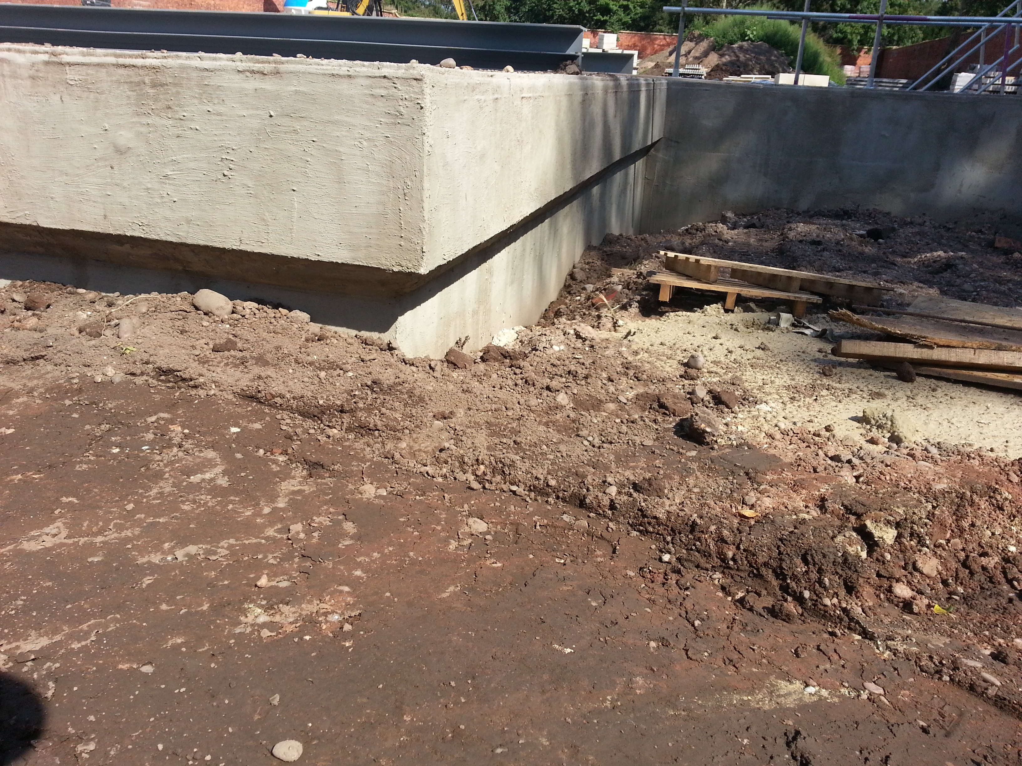 Basement walls backfilled to allow work above