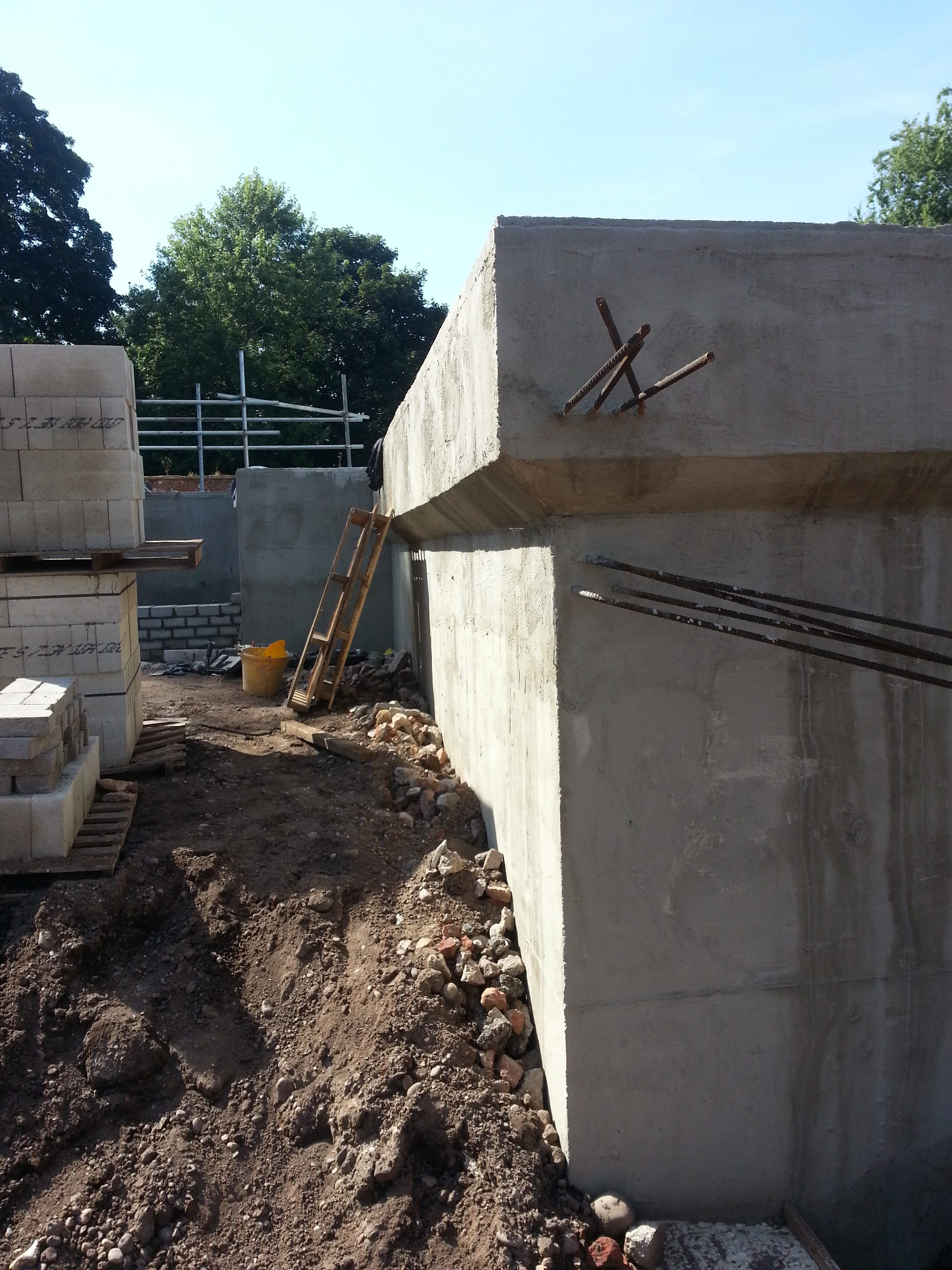 Steel reinforcing coming out of the basement walls to allow futher foundations to be joined