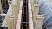 Steel reinforcing the walls, linked below to the slab steel bars