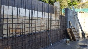 Wall poured in two sections with steel joined for continuity