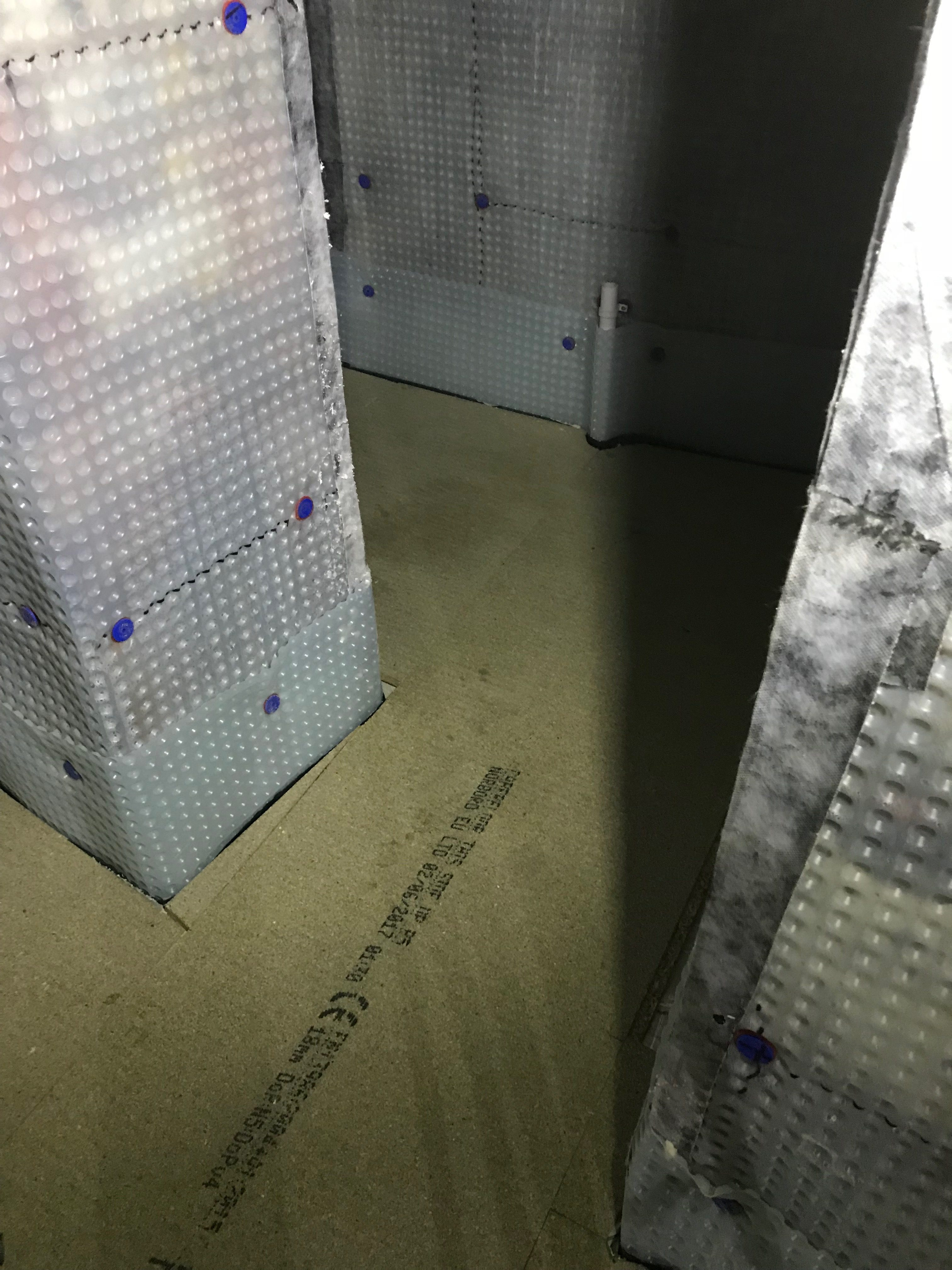 Floor membrane covered in insulation and timber