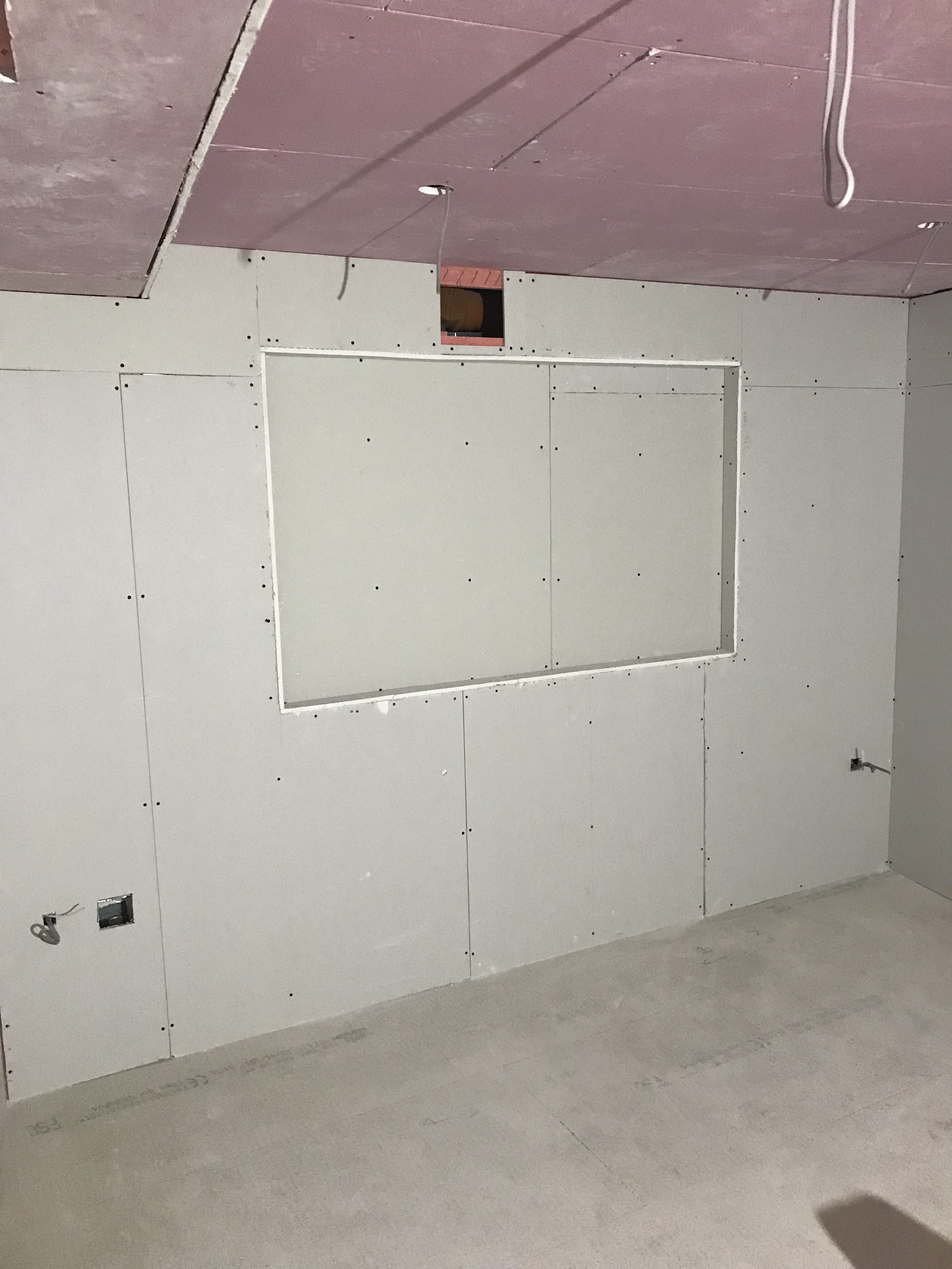 Set back in dry lining for TV