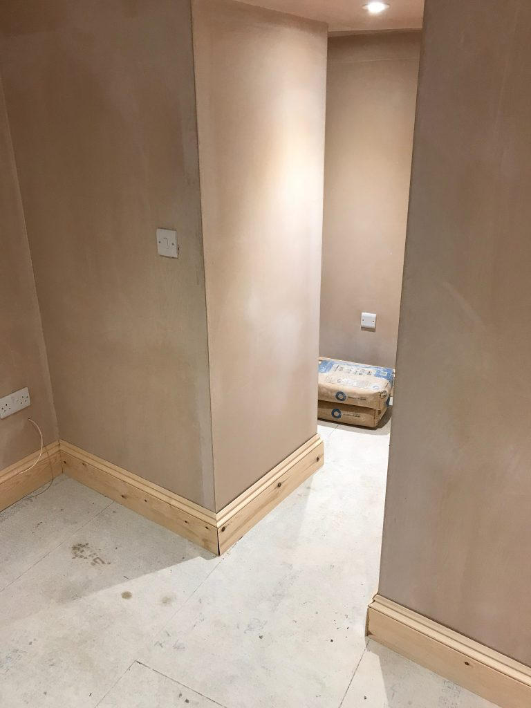 Basement plastered and finishing carpentry fit