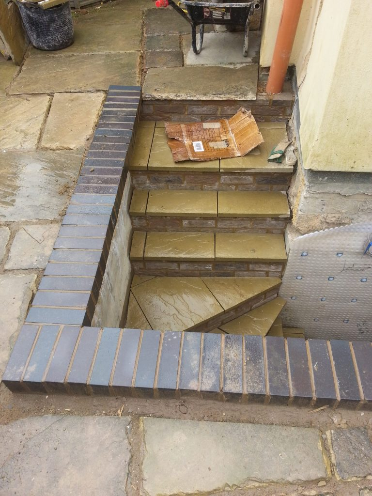 New stairs finished with stone steps