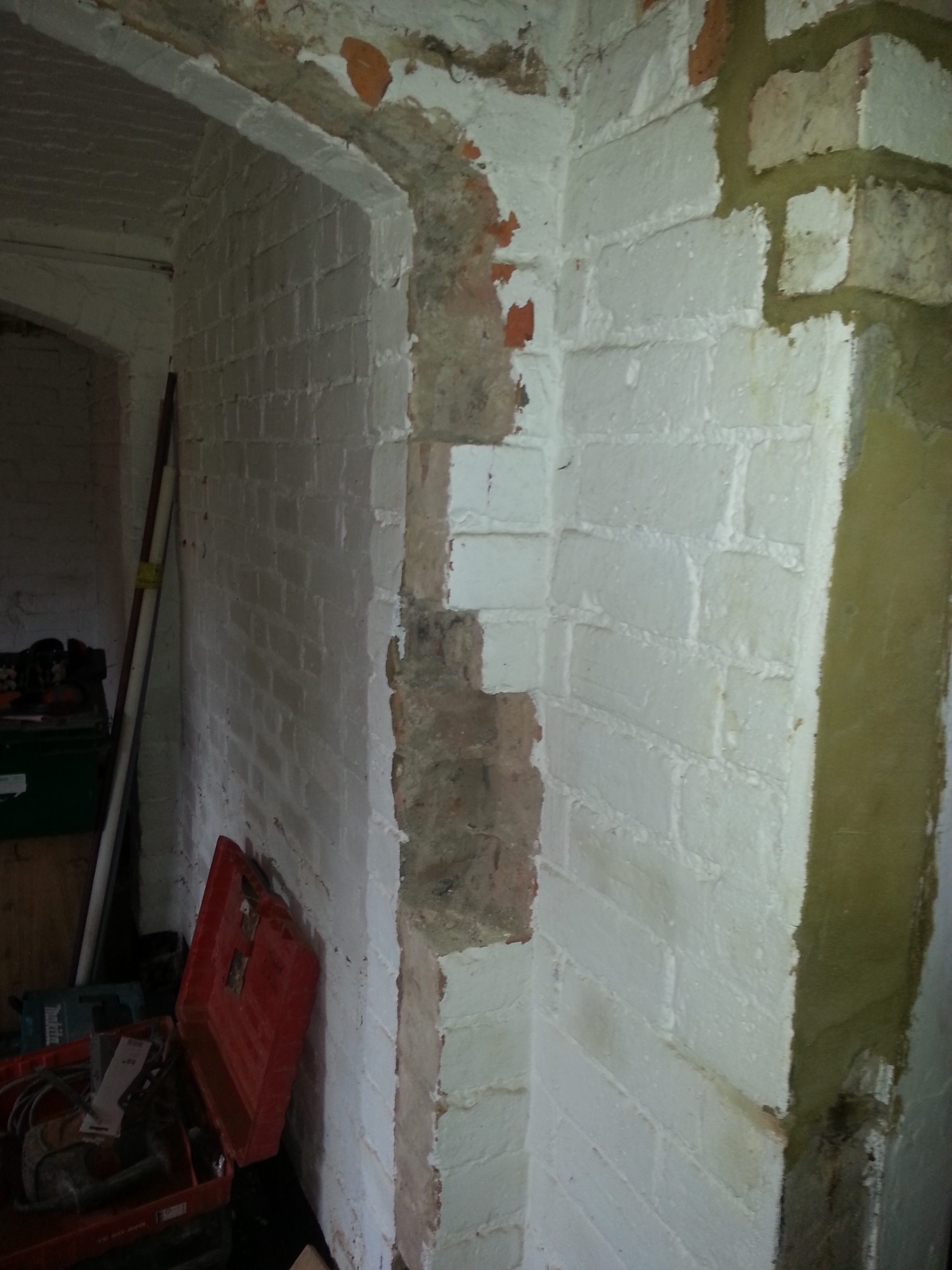All brickwork painted white and some in need of repairs
