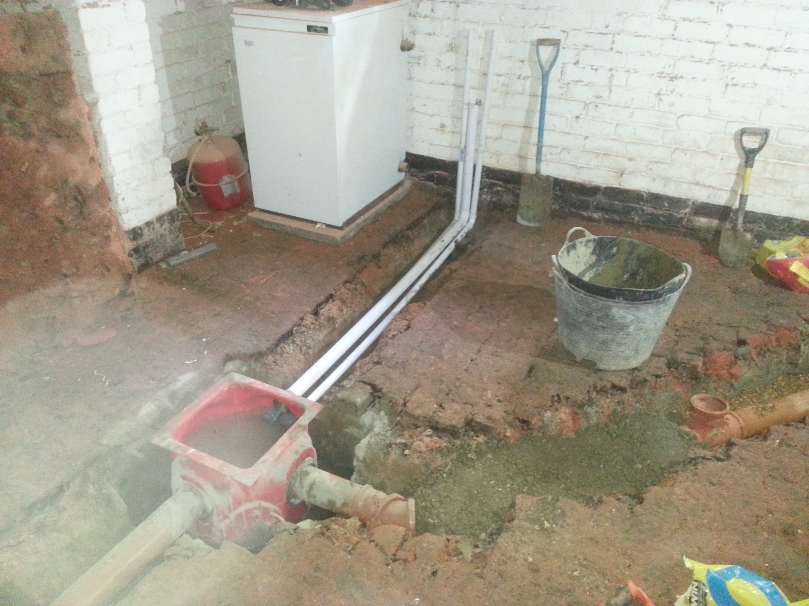 Discharge and power pipes for the sump along with underground drainage to carry water
